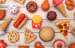 Fake Junk Food on a Wooden Table Stock Photos
