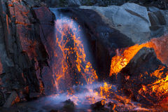 Fake Lava Waterfall and Rocks Stock Images