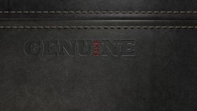 Fake Leather Conterfeit. A stitched sheet of black leather with an embossed stamp reading genuine but the one letter reads the word fake royalty free stock photography