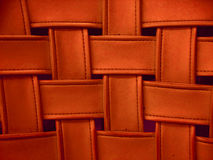 Fake leather, woven in a pattern. Orange colored fake leather, woven in a pattern. This is a detail of a vintage chair. Great for background Royalty Free Stock Photography