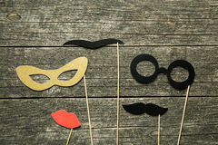 Fake lips, glasses and mustaches on sticks Stock Photo