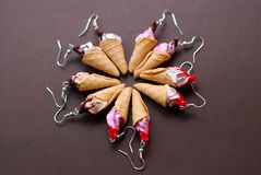 Fake Miniature Wafe Icecream Earrings. Jewellry Accesories with Different Topping on Brown Background. stock image
