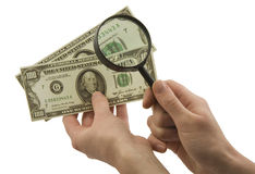 Fake money. Dollars. Magnifying glass in hands stock photo