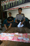 Fake money. Police arrest fake money dealers in the city of Solo, Central Java, Indonesia stock images