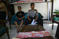 Fake money. Police arrest fake money dealers in the city of Solo, Central Java, Indonesia royalty free stock photos