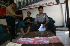Fake money. Police arrest fake money dealers in the city of Solo, Central Java, Indonesia royalty free stock image