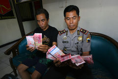 Fake money. Police arrest fake money dealers in the city of Solo, Central Java, Indonesia royalty free stock photography