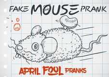 Fake Mouse Prank Doodle for a Funny April Fools` Day, Vector Illustration. Furry fake mouse prank in doodle style drawn over notebook paper for a funny April Royalty Free Stock Images