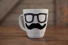 Fake moustache and spectacles on mug Royalty Free Stock Image