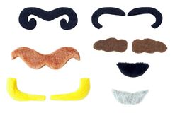 Fake Mustaches Disguise Kit. Variety of costume mustaches. Isolated royalty free stock images