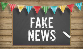 Fake News in chalk on black board Stock Images