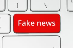Red button with Fake News words Royalty Free Stock Images