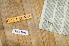 Fake News concept suggesting more clicks make more money stock photo