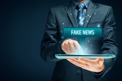 Fake news concept. Tablet user read fake news royalty free stock photography