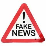 Fake news danger sign isolated over white. Warning sign, danger of fake news isolated over white background Stock Photo