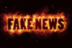 Fake news fire text flame flames burn burning hot explosion Royalty Free Stock Photography