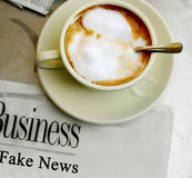 Fake News headline. Fake News newspaper headline, with morning coffee Stock Photo