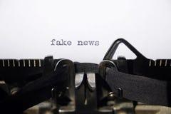 Fake news. On old typewriter Stock Photos
