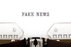 Fake News On Retro Typewriter Concept stock photos