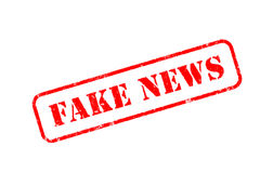 FAKE NEWS  rubber stamp over a white background Stock Photos