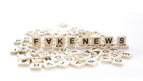 Fake News spelt out on word tiles Royalty Free Stock Photo