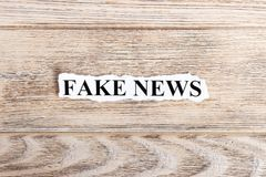 FAKE NEWS text on paper. Word FAKE NEWS on torn paper. Concept Image Stock Image