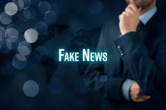 Fake news threat. Fake news concept. Politician think about fake news on internet and their global impact royalty free stock image