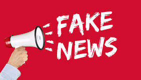Fake news truth lie media internet online megaphone. Fake news truth lie media internet online hand with megaphone Royalty Free Stock Photo