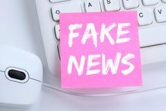 Fake news truth lie media internet online office desk concept Royalty Free Stock Images