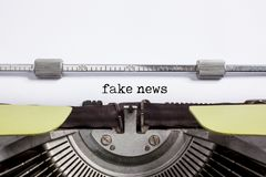 Fake news - typewrite. Fake news - vintage typewrite and White paper royalty free stock photos