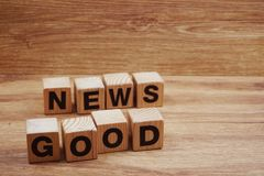Good News word alphabet letters on wooden background stock photography
