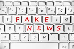 Fake news written on a computer keyboard stock image