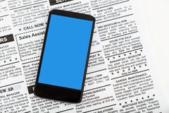 Fake newspaper and smartphone Royalty Free Stock Image