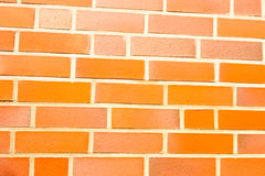 Fake ocher brick wall siding Royalty Free Stock Photos
