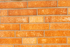 Fake ocher brick wall siding Royalty Free Stock Images