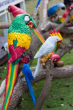 Fake parrots statue. On branch Stock Photo