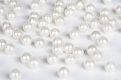 Fake pearls scattered on table Royalty Free Stock Images
