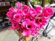 Fake pink flower on bicycle Royalty Free Stock Image