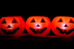 Fake plastic pumpkin with candle burning inside it Stock Photography