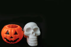 Fake pumpkin with fake white skull Royalty Free Stock Photos