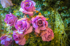 Fake purple flowers. Fake purple flowers with blur background Royalty Free Stock Photo