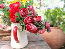 Fake red roses in the jar Royalty Free Stock Photography