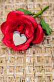 Fake rose wooden heart Stock Images