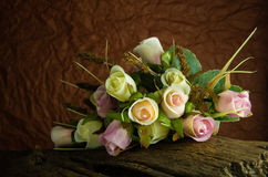 Fake roses on timber Stock Photography