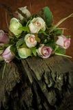 Fake roses on timber Royalty Free Stock Image