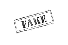 `FAKE` rubber stamp over a white background Royalty Free Stock Image