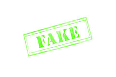 `FAKE` rubber stamp over a white background Royalty Free Stock Photos
