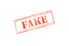 `FAKE` rubber stamp over a white background Stock Photography