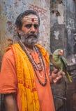 Fake sadhu with parrot Stock Image