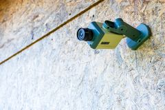 Fake security camera placed on a wooden OSB oriented strand board in sub-urban neighborhood. Concept for private home, security. With space for text stock images